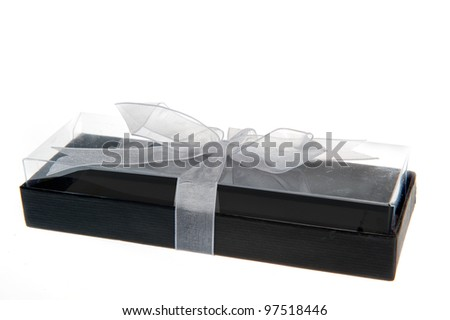 a black gift-box with a white bow