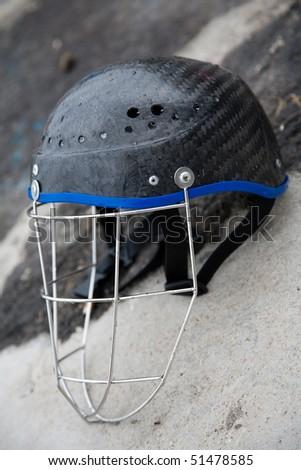 A black  helmet against a the floor - stock photo