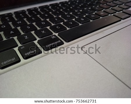 A black keypad of laptop on the desk.