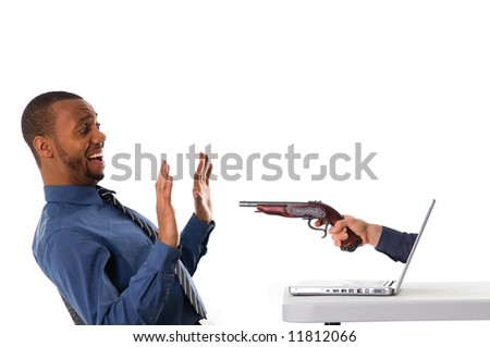 a black laptop computer with a hand and gun - stock photo