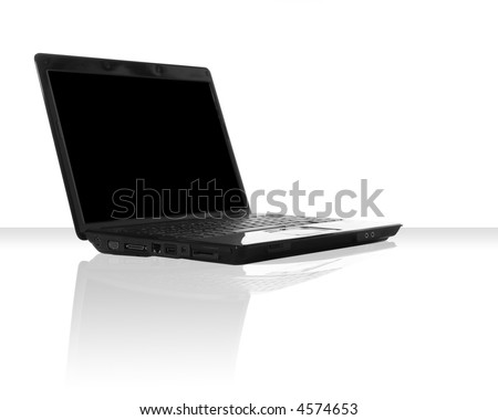 a black laptop computer with a reflection on the table