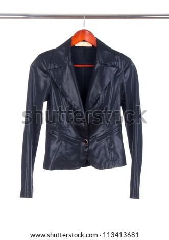 a black leather ladies jacket on a hanger isolated on white