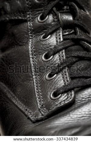 a black leather shoes lacing macro closeup - stock photo