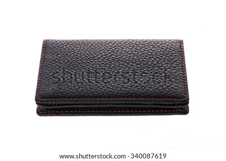 A black leather wallet with red sewing top view for working desk isolated white. - stock photo