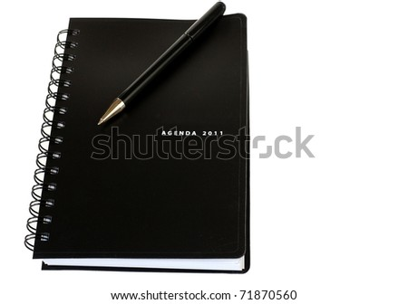 A Black Leather Writing Agenda for 2011 with a Black Ball Point Pen on Top, Isolated with Room for Text - stock photo