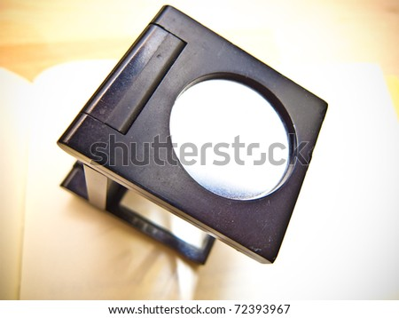 A black linen tester for checking typeset text - stock photo