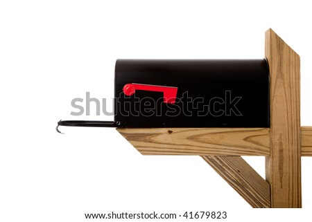 A black mailbox sitting on a wooden post on a white background - stock photo