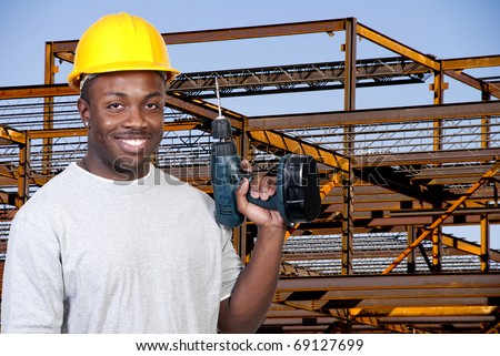 A black man African American construction worker a job site. - stock photo