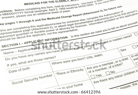 A black Medicaid applilcation waiting to be filled out. - stock photo