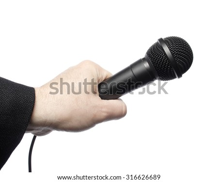 A black microphone being held by a man's hand. Isolated on white.