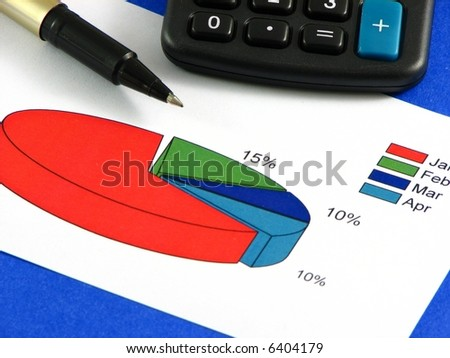 A black pen and a calculator with a big blue sum key over a pie chart on top of a blue background. - stock photo