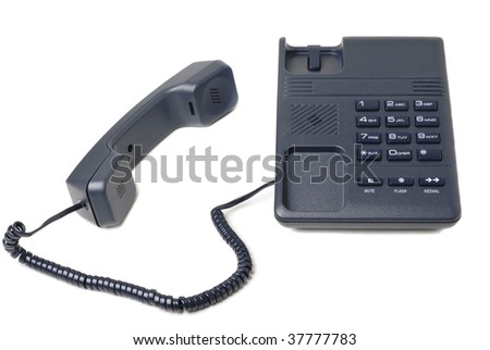 A black phone over a white background - stock photo