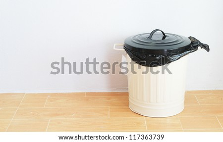 a black plastic bag in reuse disposal bin - stock photo