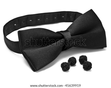A black pre-tied bow tie with matching black slik knot style cuff links - stock photo