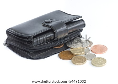 A black purse holding UK sterling coins - stock photo