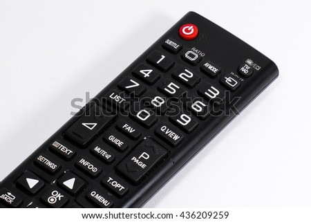 A Black Remote Control with several buttons, including a red power button on top, using to control electronics device, TV, DVD player, air conditioner, for changing channels, volume or turning off