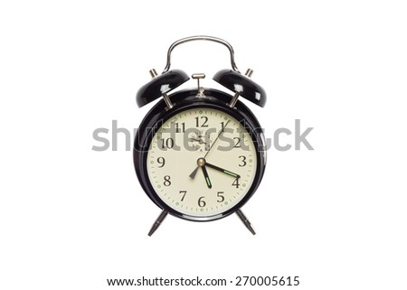 A black retro alarm clock isolated on a white background - stock photo