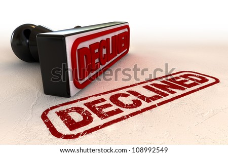 A black rubber stamp with a declined label on it and stamped in wet ink on a paper texture - stock photo