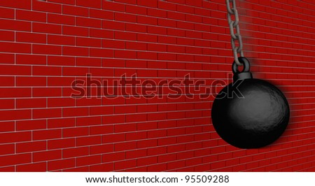 A black steel wrecking ball is about to demolish this brick wall - stock photo