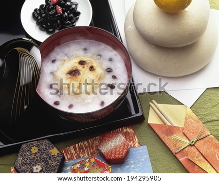 A black tray with a red bowl and white plate. - stock photo