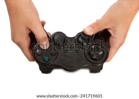 A black video game console controller being used - stock photo