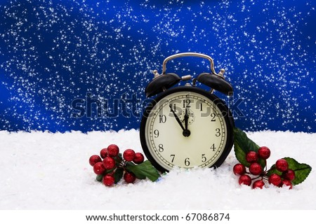 A black vintage face clock sitting on snow background, winter time - stock photo