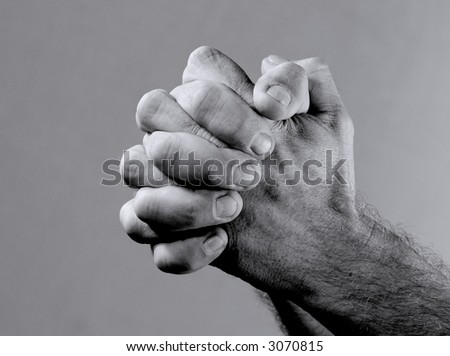 A black & white closeup image from a prayer's hand