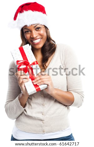 A black woman celebrating christmas carrying a gift box - stock photo