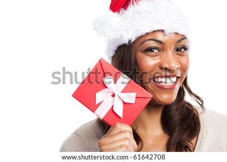 A black woman celebrating christmas holding a gift box - stock photo