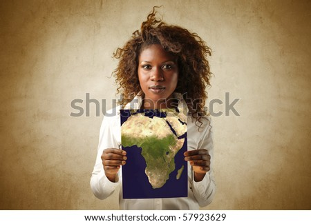 A black woman is showing a map - stock photo