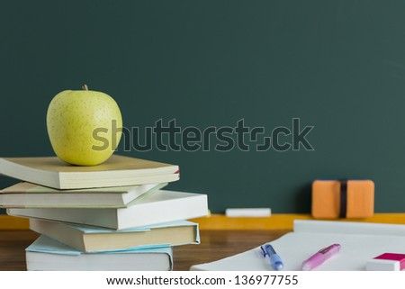 A blackboard and apple - stock photo