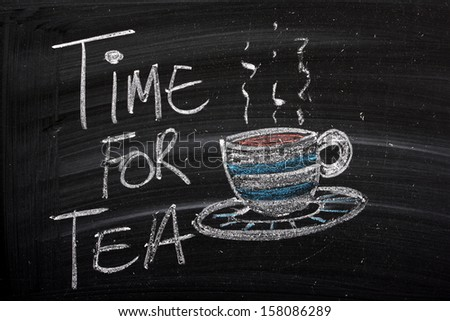 A blackboard sign with the words Time For Tea and a cup of hot tea on a saucer