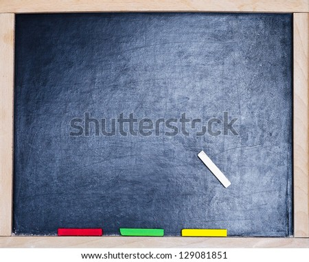 a blackboard with color chalk - stock photo