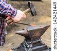 A blacksmith at work. - stock photo