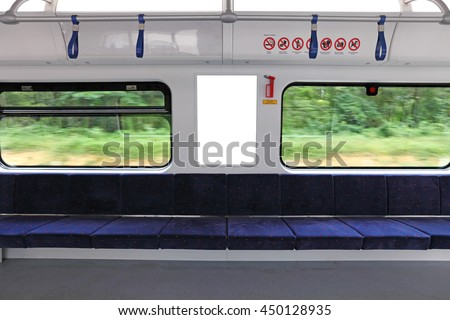 A blank advertisement panel in a fast moving train.  - stock photo