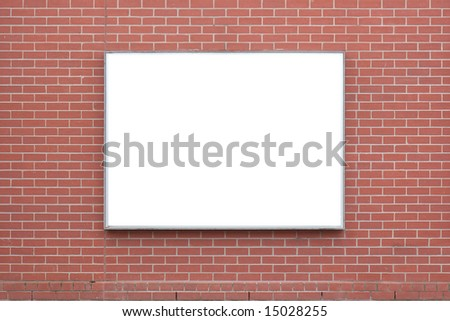 A blank billboard on a red-brick wall. - stock photo