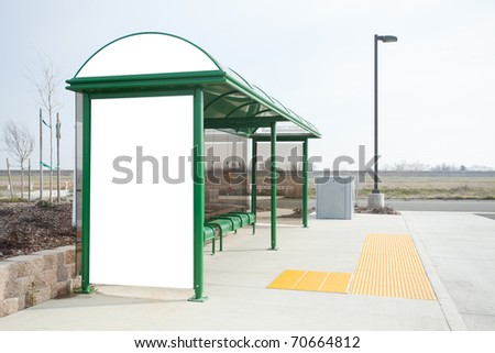 A blank billboard on the side of a bus stop - stock photo