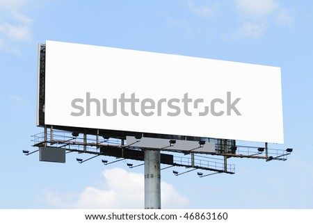 A blank billboard with a blue sky - stock photo