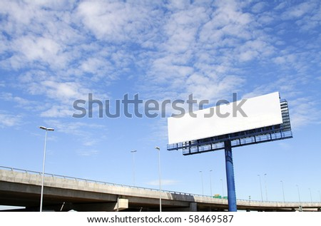 A blank billboard with an elevated highway in the background - stock photo