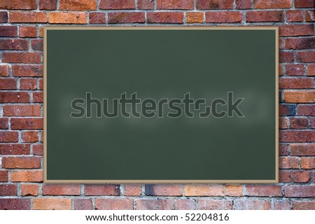 A blank blackboard against a brick wall. - stock photo