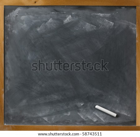 a blank blackboard and chalk straight on - stock photo