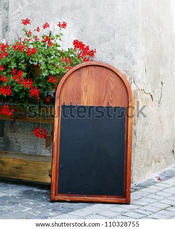 A blank blackboard in the street - stock photo