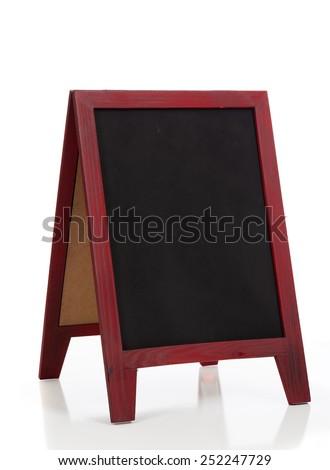 A blank chalkboard or blackboard easel on a white background - stock photo