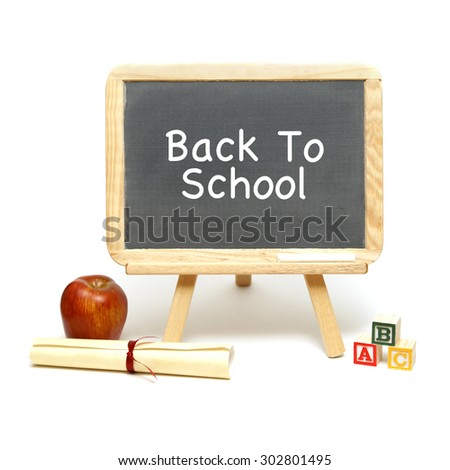 A blank chalkboard with other school items for displaying your message. - stock photo