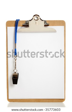A blank clipboard and a coaches whistle with copy space