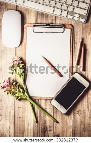 A blank clipboard with pencil on a wooden background. Copy-space, top view - stock photo