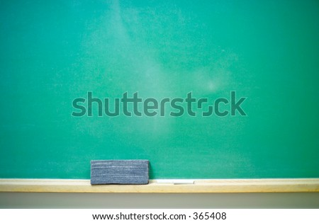 A blank green horizontal chalkboard with chalk and eraser. 14MP camera. - stock photo