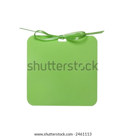 A blank green tag with a bow. - stock photo