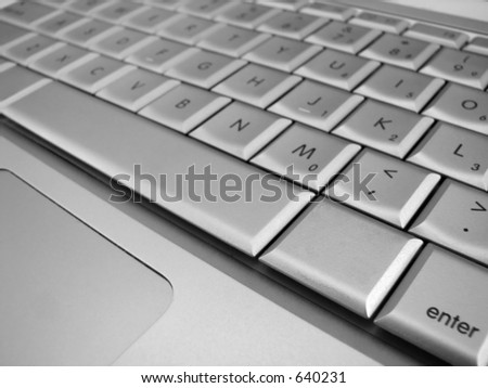 A blank key next to the space bar in focus with all the surrounding keys out of focus - stock photo