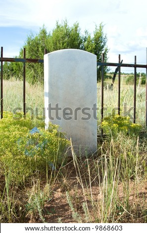 A blank marble tombstone in an old cemetary - Add Your Own Text - stock photo